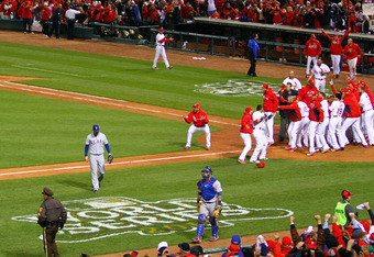 ST LOUIS, MO - OCTOBER 27:  David Freese #23 and the St. Louis Cardinals celebrate on the field after hitting a walk off solo home run in the 11th inning to win Game Six of the MLB World Series against the Texas Rangers at Busch Stadium on October 27, 201