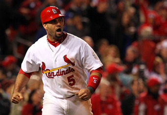 ST LOUIS, MO - OCTOBER 27:  Albert Pujols #5 of the St. Louis Cardinals celebrates after scoring on a game-tying two-run triple by David Freese #23 in the ninth inning during Game Six of the MLB World Series against the Texas Rangers at Busch Stadium on O