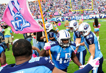 NASHVILLE, TN - OCTOBER 23:  Ahmard Hall #45 of the Tennessee Titans carries a breast cancer awareness flag in honor of his mother, a breast cancer survivor, before a game against the Houston Texans during play at LP Field on October 23, 2011 in Nashville