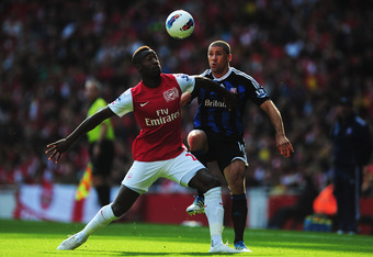 LONDON, ENGLAND - OCTOBER 23:  Johan Djourou (L) of Arsenal holds off the challenge of Jonathan Walters (R) of Stoke City during the Barclays Premier League match between Arsenal and Stoke City at the Emirates Stadium on October 23, 2011 in London, Englan