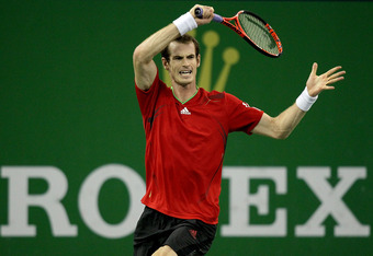 SHANGHAI, CHINA - OCTOBER 16:  Andy Murray of Great Britain returns a shot to David Ferrer of Spain during the final of the Shanghai Rolex Masters at the Qi Zhong Tennis Center on October 16, 2011 in Shanghai, China.  (Photo by Matthew Stockman/Getty Imag