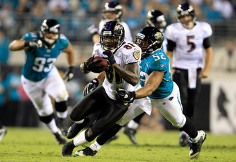 JACKSONVILLE, FL - OCTOBER 24:   Anquan Boldin #81 of the Baltimore Ravens attempts to run past  Daryl Smith #52 of the Jacksonville Jaguars during the game at EverBank Field on October 24, 2011 in Jacksonville, Florida.  (Photo by Sam Greenwood/Getty Ima