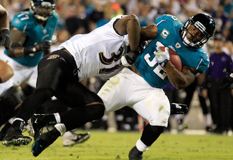 JACKSONVILLE, FL - OCTOBER 24:   Maurice Jones-Drew #32 of the Jacksonville Jaguars is tackled by  Bernard Pollard #31 of the Baltimore Ravens during the game at EverBank Field on October 24, 2011 in Jacksonville, Florida.  (Photo by Sam Greenwood/Getty I