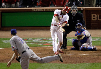 ST LOUIS, MO - OCTOBER 27: Lance Berkman #12 of the St. Louis Cardinals hits an RBI single to tie the game in the 10th inning off of Scott Feldman #39 of the Texas Rangers during Game Six of the MLB World Series at Busch Stadium on October 27, 2011 in St