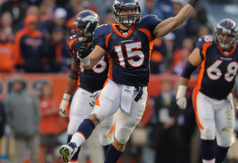 DENVER, CO - OCTOBER 09:  Quarterback Tim Tebow #15 of the Denver Broncos delivers a 31 yard pass to Daniel Fells #86 of the Denver Broncos with 19 seconds remaining in the game against the San Diego Chargers at Sports Authority Field at Mile High on Octo