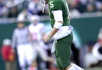 Spartan quarterback Drew Stanton slowly walks off the field after failing to convert a third down during the game between the Michigan State Spartans and the Ohio State Buckeyes at Spartan Stadium in East Lansing, Michigan on Saturday, October 14, 2006. T