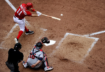 WASHINGTON, DC - SEPTEMBER 24: Ryan Zimmerman #11 of the Washington Nationals connects with a pitch against the Atlanta Braves in the seventh inning at Nationals Park on September 24, 2011 in Washington, DC. The Washington Nationals won, 4-1. (Photo by Pa