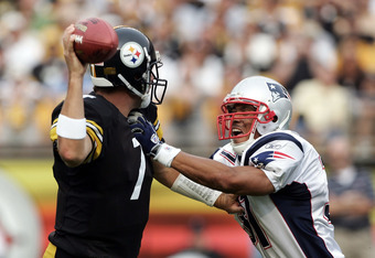 PITTSBURGH, PA - SEPTEMBER 25:  Rodney Harrison #37 of the New England Patriots pressures Ben Roethlisberger #7 of the Pittsburgh Steelers during the first quarter at Heinz Field on September 25, 2005 in Pittsburgh, Pennsylvania.  (Photo by Harry How/Gett