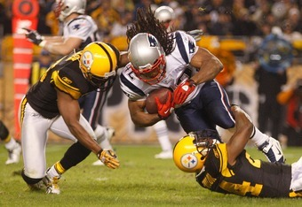 PITTSBURGH, PA - NOVEMBER 14:  BenJarvus Green-Ellis #42 of the New England Patriots attempts to run through a tackle by Ike Taylor #24 of the Pittsburgh Steelers during the game on November 14, 2010 at Heinz Field in Pittsburgh, Pennsylvania.  (Photo by