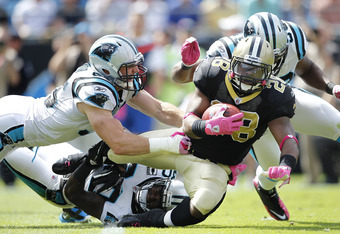 CHARLOTTE, NC - OCTOBER 9: Mark Ingram #28 of the New Orleans Saints gets tackled by Dan Connor #55 of the Carolina Panthers during the first half at Bank of America Stadium on October 9, 2011 in Charlotte, North Carolina. (Photo by Joe Robbins/Getty Imag
