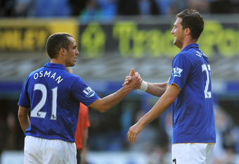 LIVERPOOL, ENGLAND - SEPTEMBER 17:  Apostolos Vellios of Everton is congratulated by team mate Leon Osman after scoring his team's second goal during the Barclays Premier League match between Everton and Wigan Athletic at Goodison Park on September 17, 20