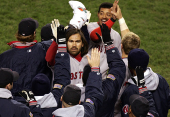 NEW YORK - OCTOBER 20:  Johnny Damon #18 and Orlando Cabere #44 of the Boston Red Sox are congratulated by their teammates after Damon hitt a two-run home run in the fourth inning against the New York Yankees during game seven of the American League Champ