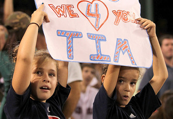 BOSTON, MA - SEPTEMBER 13:  Two fans show support for pitcher Tim Wakefield #49 of the Boston Red Sox, who is attempting t earn his 200 win, during a game against the Toronto Blue Jays at Fenway Park September 13, 2011 in Boston, Massachusetts. (Photo by