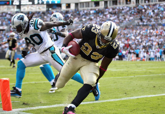 CHARLOTTE, NC - OCTOBER 09:   Pierre Thomas #23 of the New Orleans Saints scores the game winning touchdown against the Carolina Panthers during their game at Bank of America Stadium on October 9, 2011 in Charlotte, North Carolina.  (Photo by Streeter Lec