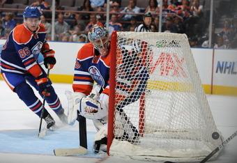 EDMONTON, CANADA - SEPTEMBER 23: Nikolai Khabibulin #35 of the Edmonton Oilers skates against the Calgary Flames on September 23, 2011 at Rexall Place in Edmonton, Alberta, Canada. (Photo by Dale MacMillan/Getty Images)