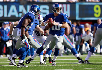 EAST RUTHERFORD, NJ - OCTOBER 16: Eli Manning #10 of the New York Giants looks to pass against the Buffalo Bills at MetLife Stadium on October 16, 2011 in East Rutherford, New Jersey.  (Photo by Nick Laham/Getty Images)