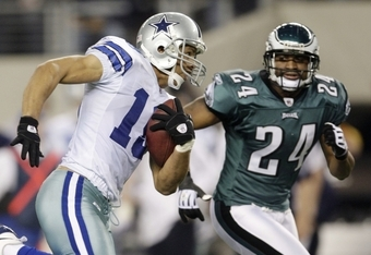 ARLINGTON, TX - JANUARY 9:  Miles Austin #19 of the Dallas Cowboys runs after a catch in the second quarter alongside Sheldon Brown #24 of the Philadelphia Eagles during the 2010 NFC wild-card playoff game at Cowboys Stadium on January 9, 2010 in Arlingto