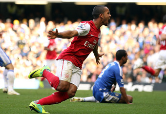 LONDON, ENGLAND - OCTOBER 29:  Theo Walcott of Arsenal celebrates scoring Arsenal's third goal during the Barclays Premier League match between Chelsea and Arsenal at Stamford Bridge on October 29, 2011 in London, England.  (Photo by Ian Walton/Getty Imag