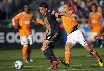 Le Toux battles for possession v Houston Dynamo