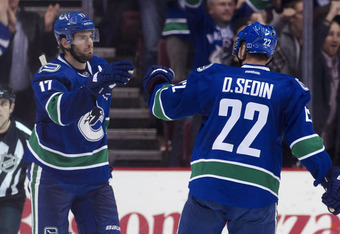 VANCOUVER, CANADA - OCTOBER 20: Ryan Kesler #17 of the Vancouver Canucks celebrates with teammate Daniel Sedin #22 after scoring against the Nashville Predators during the third period in NHL action on October 20, 2011 at Rogers Arena in Vancouver, Britis