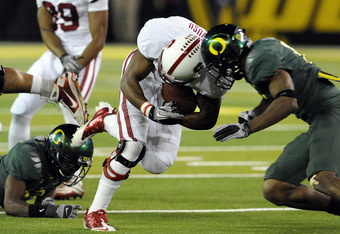 EUGENE, OR - OCTOBER 2: Wide receiver Chris Owusu #81 of the Stanford Cardinal is hit by free safety Javes Lewis #14 in the third quarter of the game at Autzen Stadium on October 2, 2010 in Eugene, Oregon. Owusu fumbled the ball and Oregon returned it for