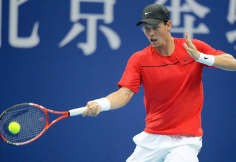 BEIJING, CHINA - OCTOBER 09:  Tomas Berdych of the Czech Republic returns a shot to Marin Cilic of Croatia during the final of the China Open at the National Tennis Center on October 9, 2011 in Beijing, China.  (Photo by Matthew Stockman/Getty Images)