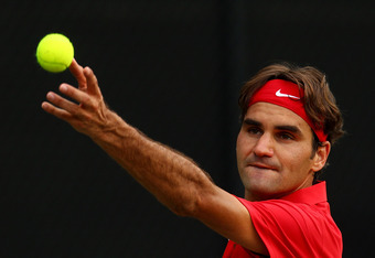 SYDNEY, AUSTRALIA - SEPTEMBER 16: Roger Federer of Switzerland serves in his Davis Cup World Group Playoff Tie match against Lleyton Hewitt of Australia at Royal Sydney Golf Club on September 16, 2011 in Sydney, Australia.  (Photo by Mark Nolan/Getty Imag