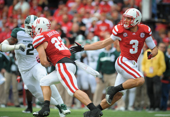 LINCOLN, NE - OCTOBER 29: quarterback Taylor Martinez #3 hands the ball to teammate running back Rex Burkhead #22 of the Nebraska Cornhuskers during their game against the Michigan State Spartans at Memorial Stadium October 29, 2011 in Lincoln, Nebraska.