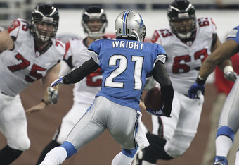 DETROIT, MI - OCTOBER 23: Eric Wright #21 of the Detroit Lions intercepts a pass from Matt Ryan #2 of the Atlanta Falcons  during the first quarter of the game at Ford Field on October 23, 2011 in Detroit, Michigan.  (Photo by Leon Halip/Getty Images)