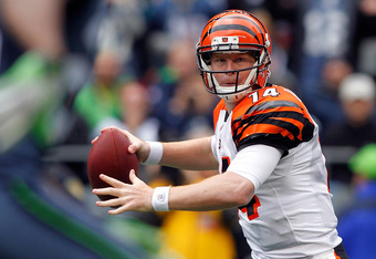 SEATTLE - OCTOBER 30:  Quarterback Andy Dalton #14 of the Cincinnati Bengals throws a pass against the Seattle Seahawks on October 30, 2011 at Century Link Field in Seattle, Washington.  (Photo by Jonathan Ferrey/Getty Images)