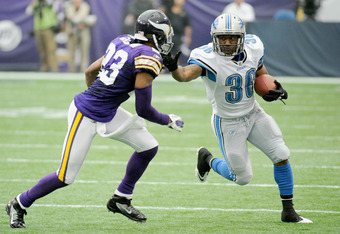 MINNEAPOLIS, MN - SEPTEMBER 25: Cedric Griffin #23 of the Minnesota Vikings looks to tackle as Jerome Harrison #36 of the Detroit Lions carries the ball in the third quarter on September 25, 2011 at Hubert H. Humphrey Metrodome in Minneapolis, Minnesota.