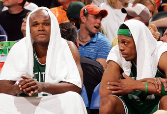 INDIANAPOLIS - APRIL 28:  Antoine Walker #8 (L) and Paul Pierce #34 of the Boston Celtics rest on the bench during the second half against the Indiana Pacers in Game three of the Western Conference Quarterfinals during the 2005 NBA Playoffs on April 28, 2
