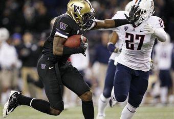 Wide receiver Kasen Williams pushes off Arizona's Tra'Mayne Bondurant