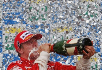 SAO PAULO, BRAZIL - OCTOBER 21:  Kimi Raikkonen of Finland and Ferrari celebrates on the podium after winning the race and the F1 World Championship at the Brazilian Formula One Grand Prix at the Autodromo Interlagos on October 21, 2007 in Sao Paulo, Braz