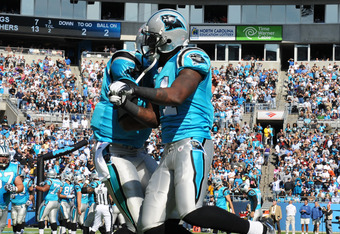CHARLOTTE, NC - OCTOBER 30:  Quarterback Cam Newton #1 and wide receiver Brandon LaFell #11 of  the Carolina Panthers celebrate a touchdown against the Minnesota Vikings October 30, 2011 at Bank of America Stadium in Charlotte, North Carolina.  (Photo by