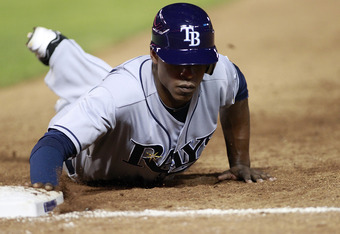 ARLINGTON, TX - AUGUST 30: B.J. Upton #2 of the Tampa Bay Rays dives back to first base against  the Texas Rangers at Rangers Ballpark in Arlington on August 30, 2011 in Arlington, Texas. (Photo by Rick Yeatts/Getty Images)