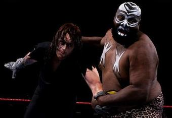 An older Undertaker incarnation battling Kamala. Photo via http://www.wwezone.org/wwe-legend/undertaker-being-beaten-by-old-wwe-supertar/
