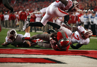 COLUMBUS, OH - OCTOBER 29:  Jordan Hall #7 of the Ohio State Buckeyes dives in for a touchdown during the third quarter against the Wisconsin Badgers on October 29, 2011 at Ohio Stadium in Columbus, Ohio. Ohio State defeated Wisconsin 33-29. (Photo by Kir