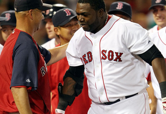 BOSTON - AUGUST 26:  David Ortiz #34 of the Boston Red Sox is congratulated by manager Terry Francona #47 after Ortiz hit a solo home run in the bottom of the 9th inning to win the game over the Chicago White Sox on August 26, 2009 at Fenway Park in Bosto