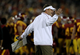 LOS ANGELES, CA - OCTOBER 29:  Head caoch Lane Kiffin of the USC Trojans complains to an official in the game with the Stanford Cardinal at the Los Angeles Memorial Coliseum on October 29, 2011 in Los Angeles, California. Stanford won 56-48 in three overt