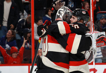 OTTAWA, CANADA - OCTOBER 30: Robin Lehner #40 of the Ottawa Senators hugs team mate Erik Karlsson #65 after defeating the Toronto Maple Leafs at Scotiabank Place on October 30, 2011 in Ottawa, Ontario, Canada.  (Photo by Jana Chytilova/Freestyle Photograp