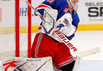 NEW YORK - NOVEMBER 14:  goalie Martin Biron #43 of the New York Rangers makes a save during a hockey game against the Edmonton Oilers at Madison Square Garden on November 14, 2010 in New York City.  (Photo by Paul Bereswill/Getty Images)