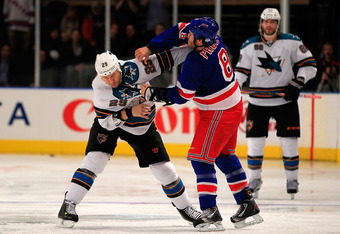NEW YORK - OCTOBER 31: Ryane Clowe #29 of the San Jose Sharks fights Brandon Prust #8 of the New York Rangers at Madison Square Garden on October 31, 2011 in New York City.  (Photo by Chris Trotman/Getty Images)