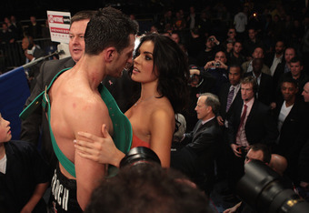 NOTTINGHAM, ENGLAND - OCTOBER 17:  Carl Froch celebrates with his girlfriend Rachel Cordingley as he retains his title against Andre Dirrell during their WBC Super Middleweight fight on October 17, 2009 at Trent FM Arena in Nottingham, England.  (Photo by