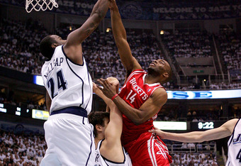 SALT LAKE CITY - APRIL 24:   Paul Millsap #24 of the Utah Jazz blocks the shot of Carl Landry #14 of the Houston Rockets  in Game Three of the Western Conference Quarterfinals during the 2008 NBA Playoffs at Energy Solutions Arena on April 24, 2008 in Sal