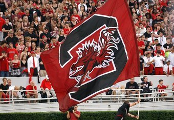 ATHENS, GA - SEPTEMBER 12:  A cheerleader of the South Carolina Gamecocks runs the end zone with a giant flag against the Georgia Bulldogs at Sanford Stadium on September 12, 2009 in Athens, Georgia.  (Photo by Kevin C. Cox/Getty Images)