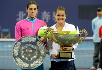 BEIJING, CHINA - OCTOBER 09:  Andrea Petkovic of Germany and Agnieszka Radwanska of Poland pose for photographers during the trophy ceremony after the final of the China Open at the National Tennis Center on October 9, 2011 in Beijing, China. Radwanska de
