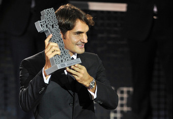 BASEL, SWITZERLAND - NOVEMBER 01:  Roger Federer of Switzerland poses with the Number 1 History-Award during day two of the Swiss Indoors at St Jakobshalle on November 1, 2011 in Basel, Switzerland.  (Photo by Harold Cunningham/Getty Images)