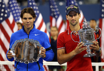 NEW YORK, NY - SEPTEMBER 12:  Novak Djokovic of Serbia holds up the winner's the trophy as Rafael Nadal (L) of Spain holds up the runner up award after Djokovic defeated Nadal during the Men's Final on Day Fifteen of the 2011 US Open at the USTA Billie Je