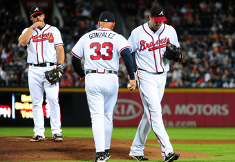 ATLANTA - SEPTEMBER 27: Derek Lowe #32 of the Atlanta Braves is removed from the game by Manager Fredi Gonzalez #33 against the Philadelphia Phillies at Turner Field on September 27, 2011 in Atlanta, Georgia. (Photo by Scott Cunningham/Getty Images)